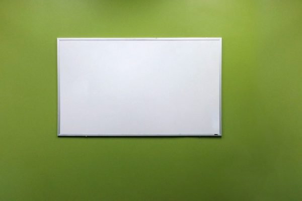 whiteboard on green wall