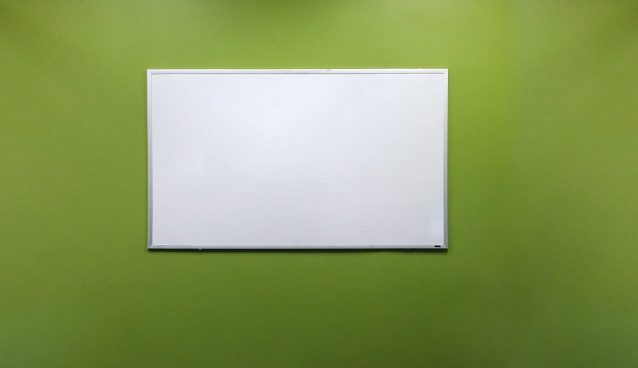 whiteboard on green wall