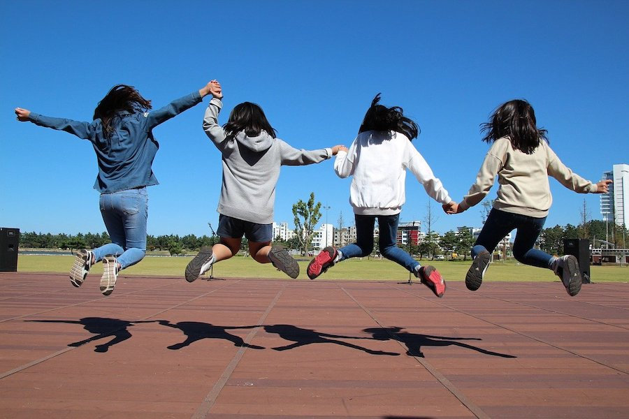 teenagers jumping