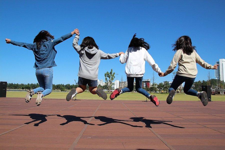 teenagers jumping